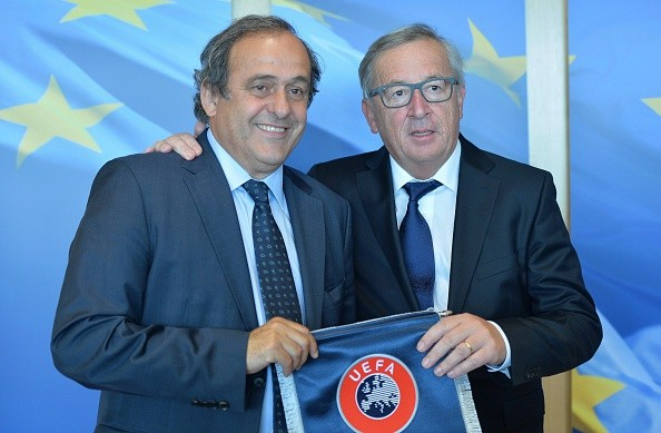 European Commission President Jean Claude Juncker (R) and the UEFA President Michel Platini (L) pose for the photographers during their meeting at the EU Commission headquarters in Brussels, Belgium, 10 September 2015.