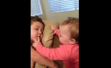 baby sister waking up her big brother