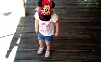 toddler walking on wood deck