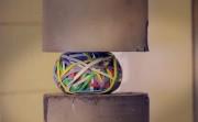rubber band ball crushing