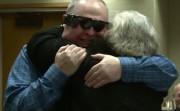 husband hugs his wife after receiving a bionic eye